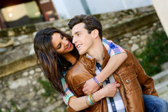 Cheerful young couple on a city street Royalty Free Stock Photography