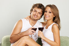 Cheerful young couple drinking wine Royalty Free Stock Photography