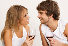 Cheerful young couple drinking wine Stock Photos