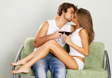 Cheerful young couple drinking wine Stock Photo