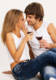 Cheerful young couple drinking wine Stock Image