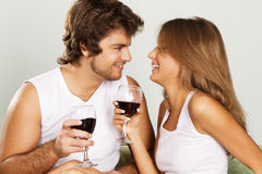 Cheerful young couple drinking wine Royalty Free Stock Photo
