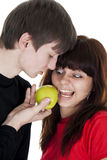 Cheerful young couple eats apple Royalty Free Stock Images