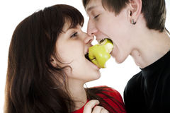 Cheerful young couple eats one apple Stock Photo
