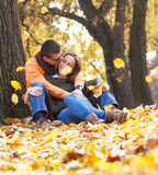 Cheerful young couple enjoy break on sunny autumn day Stock Images