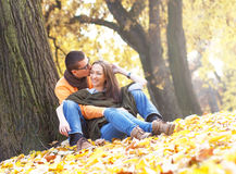 Cheerful young couple enjoy break on sunny autumn day Royalty Free Stock Photo