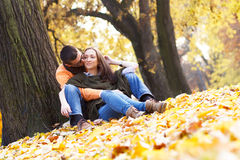Cheerful young couple enjoy break on sunny autumn day Royalty Free Stock Photography