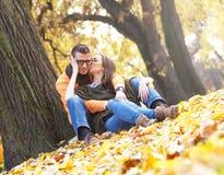 Cheerful young couple enjoy break on sunny autumn day Stock Photo
