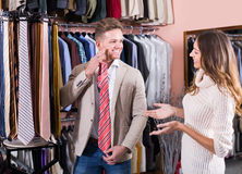 Cheerful young couple examining various ties Stock Image