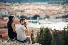 Cheerful young couple having a field trip date.Cityscape sightseeing,seaside travel vacation.Traveling in Europe. Visiting Mediterranean road trip.Romantic stock photo