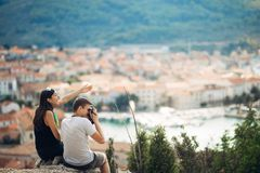 Cheerful young couple having a field trip date.Cityscape sightseeing,seaside travel vacation.Traveling in Europe. Visiting Mediterranean road trip.Romantic stock photos