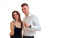 Cheerful young couple having fun and drinking champagne Royalty Free Stock Photos