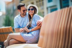 Young couple having fun and laughing together outdoors royalty free stock images