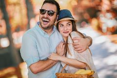 Young couple having fun and laughing together outdoors, selective focus royalty free stock images