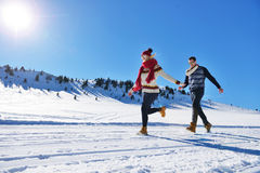 Cheerful young couple having fun in winter park Stock Photos