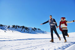 Cheerful young couple having fun in winter park Stock Photo