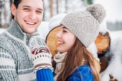 Outdoor portrait of young sensual couple in cold winter wather. love and kiss royalty free stock images