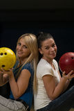 Cheerful Young Couple Holding Bowling Ball Stock Images