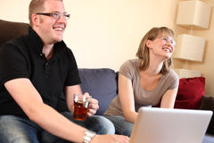 A Cheerful Young Couple at Home Royalty Free Stock Photos