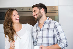Cheerful young couple at home Stock Photography