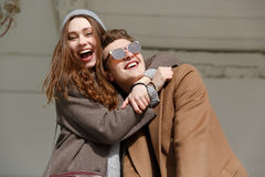 Cheerful young couple hugging and having fun outdoors Royalty Free Stock Photography