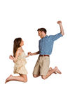 Cheerful young couple jumping Royalty Free Stock Photos