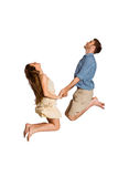 Cheerful young couple jumping Royalty Free Stock Images