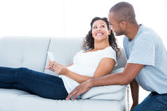 Cheerful young couple looking at each other Royalty Free Stock Photos