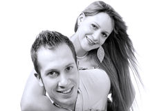 Cheerful young couple in love in black and white background Stock Photography