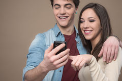 Cheerful young couple with mobile phone Stock Photo