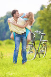 Cheerful Young Couple Piggyback Having Fun Outdoors Stock Photos