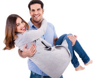 Cheerful young couple piggybacking Stock Image