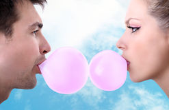 Cheerful young couple playing with chewing gum Royalty Free Stock Photos