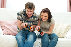 Cheerful young couple playing console Royalty Free Stock Image