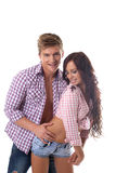 Cheerful young couple posing in plaid shirts Royalty Free Stock Images