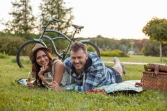 Cheerful young couple is relaxing in the nature royalty free stock image