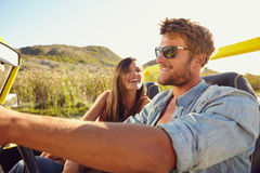 Cheerful young couple on a road trip Stock Images