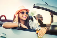 Cheerful young couple on road trip royalty free stock photos
