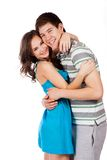 Cheerful young couple standing on white background Royalty Free Stock Photos