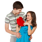 Cheerful young couple standing on white background Royalty Free Stock Images