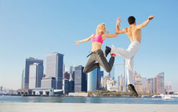 Cheerful young couple training together Stock Images