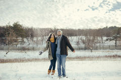Cheerful young couple walking in a winter day Royalty Free Stock Photo