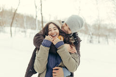 Cheerful young couple walking in a winter day Stock Photography