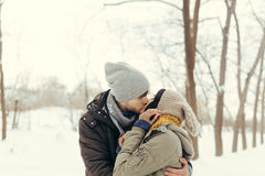 Cheerful young couple walking in a winter day Stock Photos