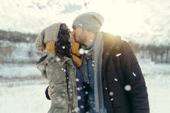 Cheerful young couple walking in a winter day Stock Images