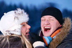 Cheerful young couple at winter evening Stock Image