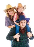 Cheerful young cowboy family in hats, mom dad and Stock Photos