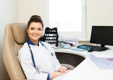 Cheerful young doctor woman Stock Photos