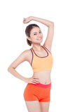 Cheerful young exercising woman, isolated over white background Royalty Free Stock Photography