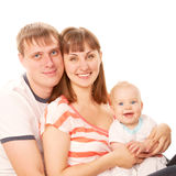 Cheerful young family. Father, mother and baby Stock Photos